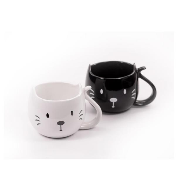 Skodelica za čaj Trixie s simpatičnim motivom bele in črne mucke.